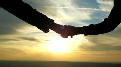 stock-footage-sunset-handshake